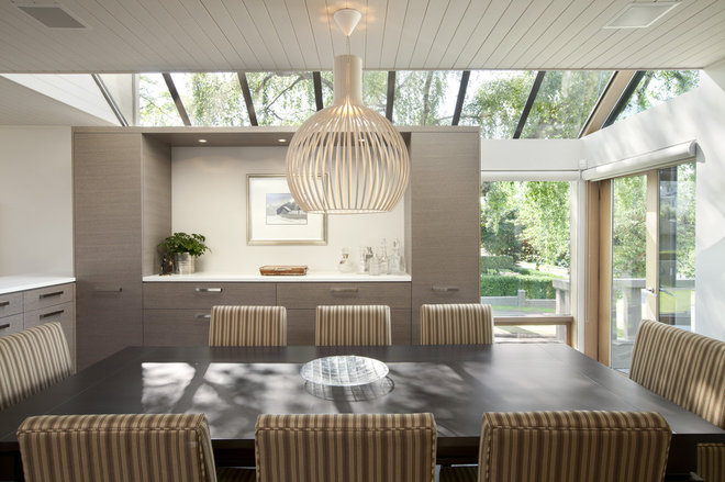 Contemporary Dining Room by Best Builders ltd