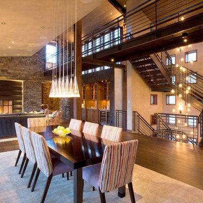 Great room - large contemporary dark wood floor and brown floor great room idea in Denver with beige walls