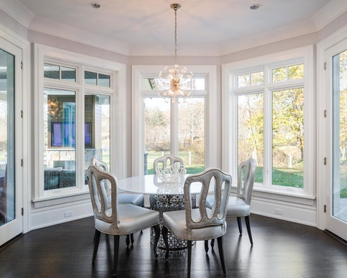 Example Of A Transitional Dark Wood Floor And Brown Enclosed Dining Room Design In New