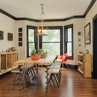 Mid-sized urban dark wood floor enclosed dining room photo in Detroit with beige walls