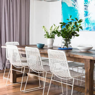 Inspiration for a contemporary dining room in Melbourne with white walls and dark hardwood floors.