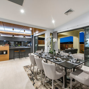 Contemporary open plan dining in Canberra - Queanbeyan with white walls and beige floor.