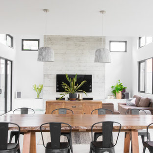 This is an example of a contemporary open plan dining in Sydney with white walls and beige floor.