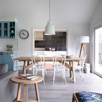 Example of a mid-sized trendy medium tone wood floor great room design in Melbourne with white walls