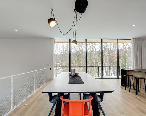 Modern Kitchen/dining Combo In Grand Rapids With White Walls And Light  Hardwood Floors.