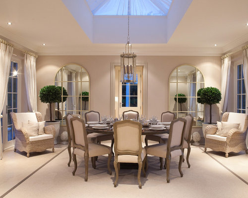 Example Of A Classic Carpeted Enclosed Dining Room Design In London With  Beige Walls