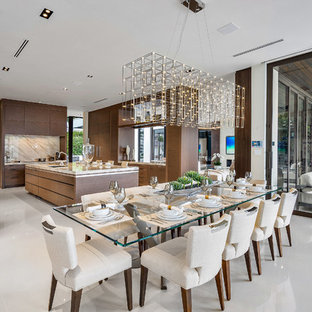 Large trendy marble floor and white floor kitchen/dining room combo photo in Miami with beige walls