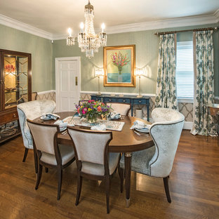 Mid-sized transitional medium tone wood floor dining room photo in Raleigh with green walls