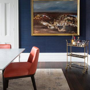 Ejemplo de comedor ecléctico, grande, cerrado, con paredes azules, suelo de madera oscura, chimenea tradicional, marco de chimenea de madera y suelo marrón