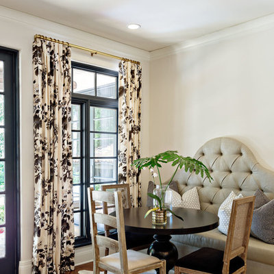 Inspiration for a mediterranean medium tone wood floor dining room remodel in Orange County with beige walls