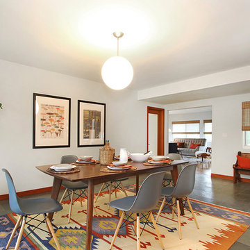 Bold Kilim Wool Rug with Eames Dining Chairs and Fiddle Leaf Fig