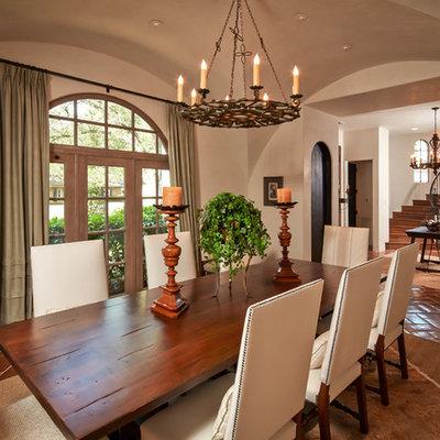 Dining room - mediterranean terra-cotta tile dining room idea in Houston