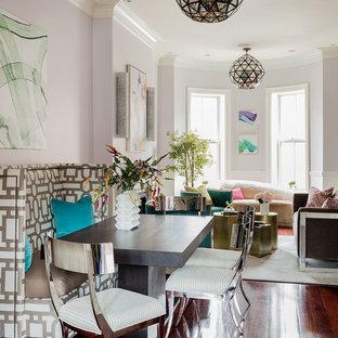 Idées déco pour une salle à manger ouverte sur le salon contemporaine de taille moyenne avec un mur violet, un sol en bois brun, une cheminée standard et un manteau de cheminée en plâtre.