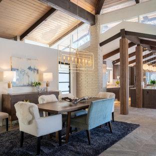 На фото: гостиная-столовая в стиле рустика с серыми стенами, серым полом, балками на потолке, сводчатым потолком и деревянным потолком с