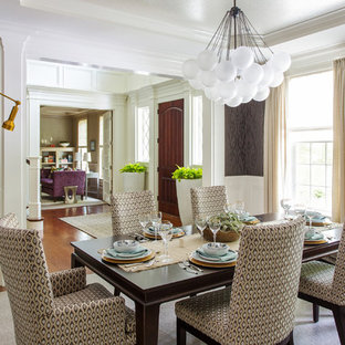 Design ideas for a traditional enclosed dining room in Boston with purple walls.
