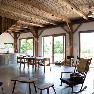 Mountain style concrete floor dining room photo in New York
