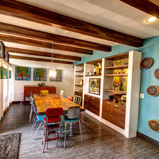 Inspiration for a mid-century modern dining room remodel in Grand Rapids with blue walls