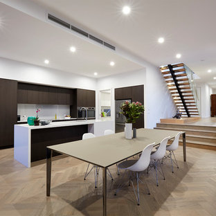 Design ideas for a contemporary kitchen/dining combo in Melbourne with white walls, light hardwood floors, no fireplace and beige floor.