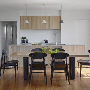 Contemporary kitchen/dining combo in Melbourne with white walls, medium hardwood floors, no fireplace and brown floor.