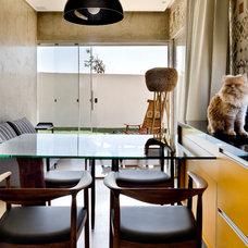 Modern Dining Room by 1:1 arquitetura:design
