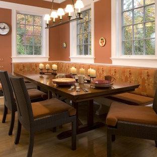 Immagine di una sala da pranzo minimal con pareti arancioni