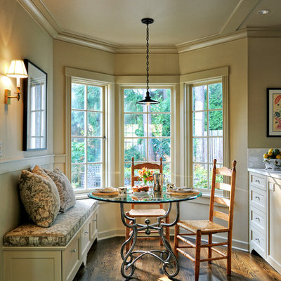 Example of a mid-sized classic dark wood floor kitchen/dining room combo design in Seattle with beige walls and no fireplace