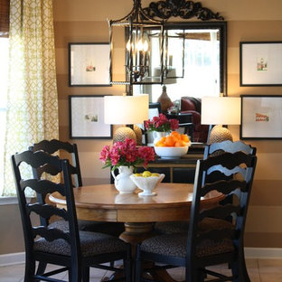 Dining room - contemporary ceramic floor dining room idea in Charlotte with brown walls