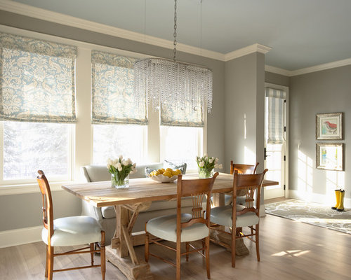 Example Of A Classic Light Wood Floor Dining Room Design In Minneapolis  With Gray Walls