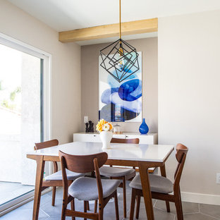 Dining room - contemporary ceramic floor and gray floor dining room idea in San Diego with beige walls