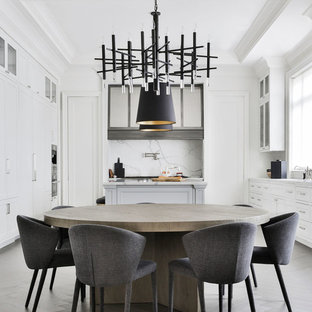 Kitchen/dining room combo - contemporary gray floor kitchen/dining room combo idea in Toronto with white walls