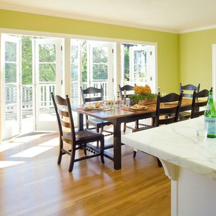 Example of a mid-sized classic medium tone wood floor kitchen/dining room combo design in San Francisco with green walls