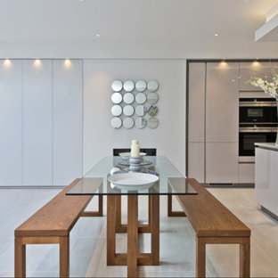 Inspiration for a medium sized contemporary kitchen/dining room in London with white walls and grey floors.