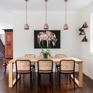 Mid-sized transitional kitchen/dining combo in Sydney with white walls and medium hardwood floors.