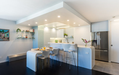 Curvaceous Custom Island Wows in a Sleek White Kitchen