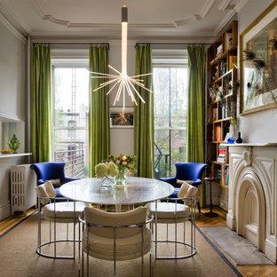 Foto de comedor ecléctico con paredes blancas y suelo de madera en tonos medios