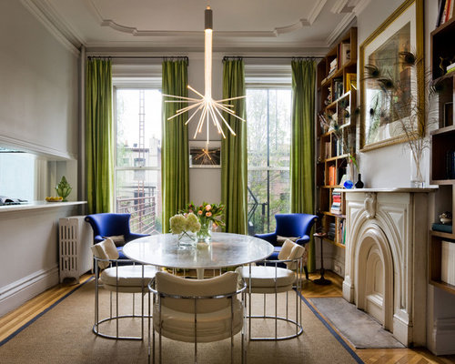 Eclectic Medium Tone Wood Floor Dining Room Idea In New York With White Walls