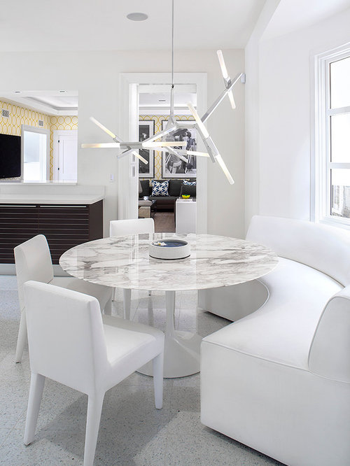 Good Large Trendy Ceramic Floor Dining Room Photo In New York With White Walls