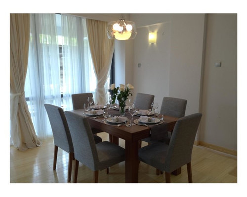 Example Of A Trendy Dining Room Design In Other