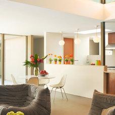 Midcentury Dining Room by BiLDEN