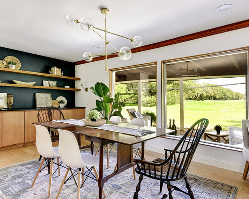 Example Of A Country Light Wood Floor And Beige Enclosed Dining Room Design In Austin
