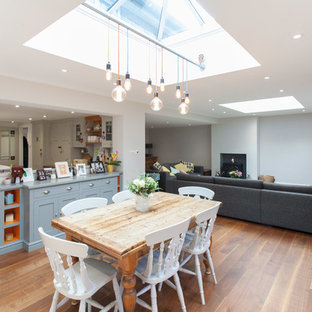 This is an example of a medium sized traditional kitchen/dining room in Hampshire with medium hardwood flooring.