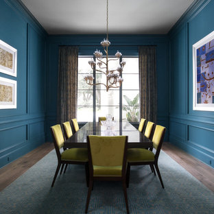 Enclosed dining room - beach style medium tone wood floor enclosed dining room idea in Jacksonville with blue walls and no fireplace