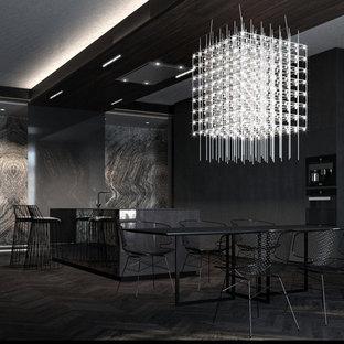 Esempio di una sala da pranzo aperta verso il soggiorno contemporanea con pareti nere, parquet scuro e pavimento nero