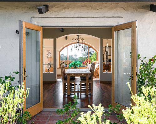Mediterranean Dining Room In San Luis Obispo With White Walls Medium Hardwood Floors And Brown