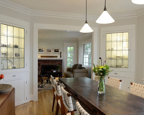 Attirant Example Of A Classic Medium Tone Wood Floor Dining Room Design In Portland  With Gray Walls