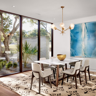Example of a trendy dark wood floor dining room design in Austin with white walls