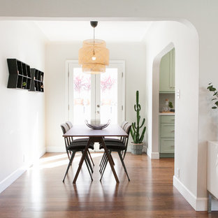 Kitchen/dining room combo - contemporary medium tone wood floor and brown floor kitchen/dining room combo idea in Los Angeles with white walls