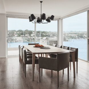 Photo of a large contemporary kitchen/dining combo in Sydney with light hardwood floors.