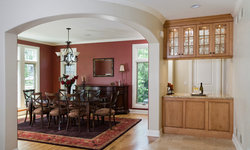 Butlers Pantry Abuts Complex Curve on Arched Opening to Dining Room