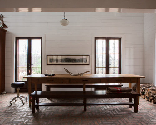 Large Mountain Style Brick Floor Dining Room Photo In Montreal With White  Walls